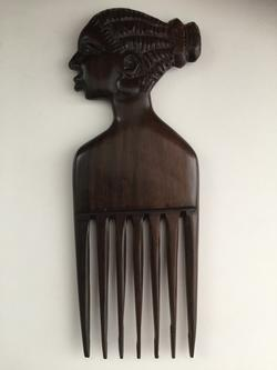 Handcarved comb of wood, lady